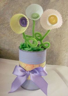 Mother's Day bouquet made with painted soup can, green tissue paper, patterned paper and ribbon for around can, cupcake liners, pipe cleaners and buttons or beads to decorate inside of flowers.