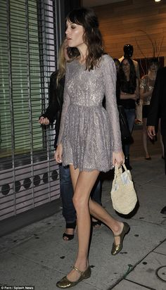Alexa Chung turns heads in micro-mini dress: soft greys and gold flats.