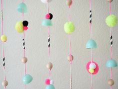 To make an easy room divider or window treatment embellishment, drill holes in plastic egg halves. String them onto yarn, and express your creativity by adding beads, patterned paper straws and pom poms in any variation. Room Divider Headboard, Metal Room Divider, Small Room Divider, Room Divider Bookcase, Divider Cabinet, Bamboo Room Divider, Living Room Divider, Room Divider Walls, Diy Room Divider