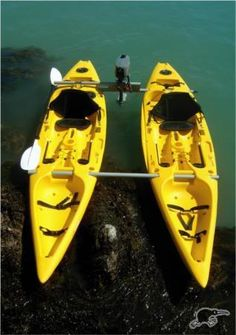 I+have+plans+to+build+one+of+these+for+myself+when+I+can+afford+it.Two+Kayaks,+that+can+be+joined+to+form+a+catamaran,+easily+stable+enough+to+fish+or+shoot+from,+you+can+carry+a+heap+of+gear,+and+they+can+be+2+kayaks+instead+of+a+boat+if+you+want+instead.I+would+have+it+so+the+beams+join+on+the+deck+and+have+a+cargo+net+between+the+hulls.Extra+bracing+to+the+motor+bracket+to+accept+a+4hp+out+board.