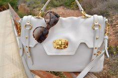 white and gold bag