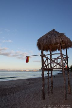 """""""Life Guard Tower"""" - This palapa style life guard tower was photographed in Puerto Vallarta, Mexico."""