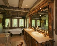 A custom-designed concrete countertop rests on a reclaimed timber vanity base in this Western Mine-style guest bath.