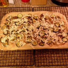 Tonight's pizza is again 100% vegan... This time with whole wheat crust, grilled zucchini and onions, truffle oil and daiya mozzarella.