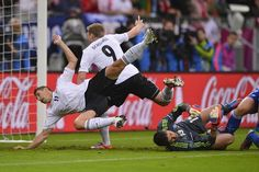 German forwards Miroslav Klose, left, and André Schuerrle, center, both move in front of the Greek goal