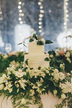 Tiered wedding cake from this green and white destination wedding // TV hosts Henry and Liv tied the knot at Cove 55 in Kuching, Sarawak, in a three-day affair that involved drinks, pizza, and a huge pool.