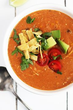 Easy, cheesy, and healthy creamy slow cooker chicken enchilada soup.