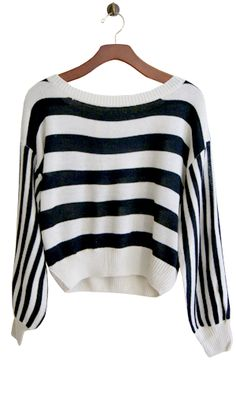 Earn your style stripes with this dolman sleeve cropped sweater with mixed stripes. Layer it with a tank and jeans during the day, or wear it alone with a swingy mini skirt for a bold night time look.