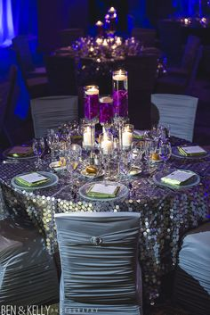Purple and grey wedding, floating candles, submerged orchids, candle centerpieces, Sequin linen, Chair covers. ~BTS Event Management