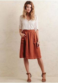 Polished and chic, this darling midi skirt is designed in a rustic red tone perfect for fall. Finished with box pockets at the sides and soft pleating at the waistband, this flowy skirt easily tr...