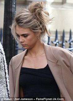 She scrubs up well! Cara Delevingne looked positively glowing as she arrived at her big si...