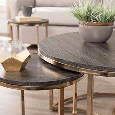 Update your space with the Lachlan Nesting Coffee Table. Round tabletops and sleek metal bases combine for an eclectic, glamorous look in this living room table set. Two side tables slide out from underneath for additional serving space. Round Nesting Coffee Tables, Coffee And End Tables, End Table Sets, Nesting Tables, Side Tables, Occasional Tables, Nesting Boxes, Large Table, Small Tables