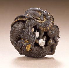 Dragon Guarding the Jewel of the Buddha  Mitsukiyo (Japan, active 19th century)  Japan, 19th century  Costumes; Accessories  Iron, gilt, diamond  1 x 1 1/16 x 3/8 in. (2.6 x 2.7 x 1.0 cm)