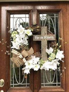 HE IS RISEN Spring grapevine wreath with faux flowers and lots of extra lilies. Wooden cross with vinyl lettering