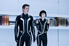 Picture: Garrett Hedlund and Olivia Wilde in 'Tron: Legacy.' Pic is in a photo gallery for 'Tron: Legacy' featuring 94 pictures. Costume Tron, Olivia Wilde Tron Legacy, Tron: O Legado, Lynda Barry, Brave Witches, Garrett Hedlund, Cyberpunk Girl, Joan Of Arc, Picture Photo
