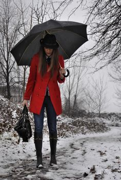 Love the red jacket, the black boots, the bag and of course the umbrella is pretty sweet
