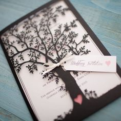 Wow your guest with this stunning lasercut wedding invitation.  Detailed tree with heart cut out includes printed insert. Decorated with ribbon and tag on the front  Shown in Black with pink accents.  Approx Size: 180mm x 125mm  Invitations come complete with envelopes