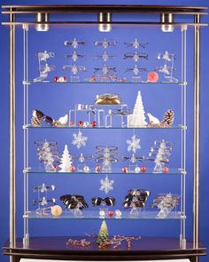 great shelf idea, using odd numbers and props to make the display more eye catching and interesting. As well as making the props seasonal giving the whole display a feel and theme