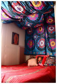 DIY tapestry headboard. This would be a cool way to dress up your college dorm room very easily.