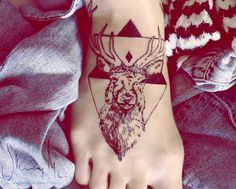 Deer tattoo with geometric background