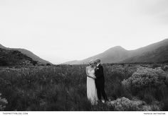 Misty mountain wedding couple shoot ideas with a plain simple wedding dress and elegant black grooms suit | Photography by Knit Together