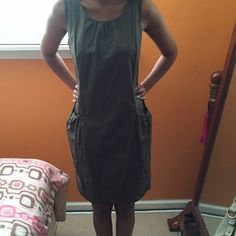Casual dress As you can see this is extremely loose on me. And the tag says size S. Would probably fit a M best. Never worn. Has 2 pockets on the sides. The color is more of a gray in person. Not from listed brand. Zara Dresses