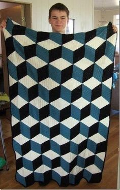 Isometric throw, free pattern by Solveig Grimstad. This uses DC for the diamond motifs, rather than the SC in the 'Vasarely' throw pattern . Crochet Afghans, Crochet Quilt, Crochet Stitches, Crochet Blankets, Crochet Crafts, Easy Crochet, Crochet Projects, Free Crochet, Diy Crafts
