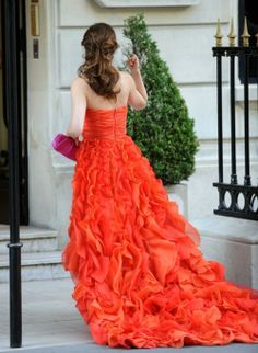 Love the orange color and all the ruffles... But seriously ... The pink purse needs to go !!!!