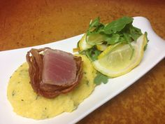 Bacon wrapped ahai over creamy polenta served with a arugula and lemon ...