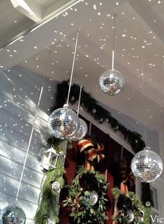 We need some disco balls! decorated for Christmas… And a DIY bow tutorial. I am LOVING the disco ball idea in with the Christmas decor. Gives that snow falling look when the light reflects off! Christmas Door Decorations, Christmas Porch, Outdoor Christmas, Winter Christmas, All Things Christmas, Christmas Lights, Christmas Ornaments, Funny Christmas, Ball Decorations