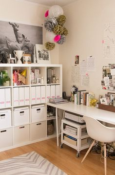 Organised Studio workspace. Filing shelves. Storage. White with colour pops