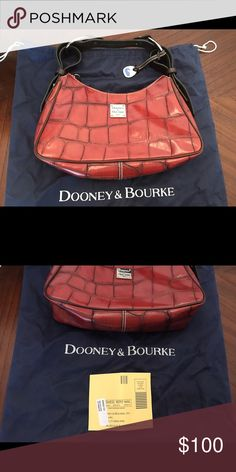 Dooney & Bourke brand new purse This gorgeous deep red leather croc embossed medium hobo bag will definitely turn heads! Chocolate brown leather strap is adjustable. Zipper top. Has storage bag and certificate of authenticity. Pd 300. A true find! Dooney & Bourke Bags Hobos
