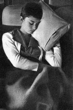 Audrey Hepburn sleeping on a plane