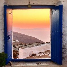 A Lovely window with this stunning view , at Sikinos island (Σίκινος) . Absolutely Magical colors at the background , looks exactly like painting !! Sunset time is always a great idea.