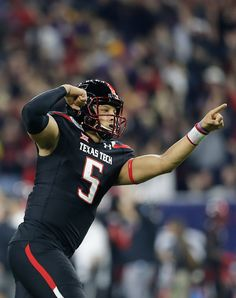 Texas Tech Red Raiders quarterback Patrick Mahomes celebrates a touchdown  throw against the LSU Tigers at NRG Stadium. LSU won 56 to 489af1f9e