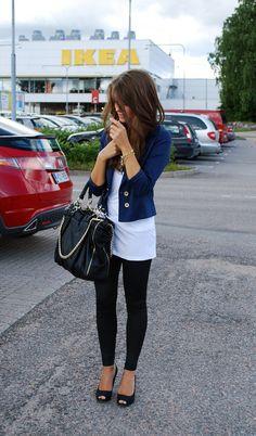 Black leggings, white top, blue blazer.