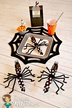 How to Make Halloween Spider Napkins ~ To make these easy Halloween spider napkins you'll need a polka dot dessert napkin, black plastic silverware, and black pipe cleaners. Roll the Halloween napkin around a black plastic fork and spoon and wrap with black pipecleaners...