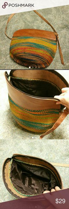 70's Woven Hobo Bag Beautifully new woven bucket 70's style hobo bag over the shoulder strap. Leather with an imported feel. New the more you use and wear the more amazing this bag will get. Bags Hobos