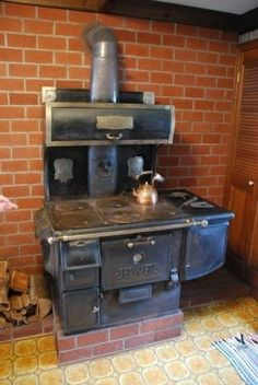 Beautiful wood burning cooking stove that took up 1/3 of the kitchen. Sold at auction.  Brick wall is gone too!