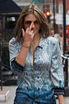LIZ HURLEY, she goes for the subtle finger