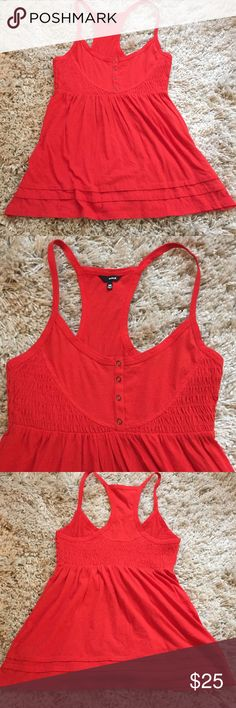 Hurley Tank Top ❤️️ + EUC!  + Great red color 😍 + Bottom hem detail  + Dont forget to bundle 🛍  ⭐️All items are steamed cleaned and shipped within 48 hours of your purchase. ⭐️If you would like any additional photos or have any questions please let me know. ⭐️Sorry, no trades. But will listen to ALL fair offers. Thanks for shopping! Hurley Tops Tank Tops
