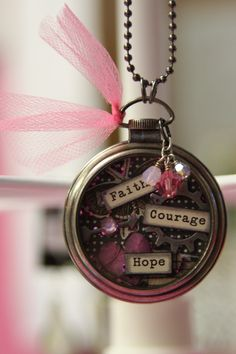 Tim Holtz Altered Pocketwatch with Glitter inside. These are pretty cool