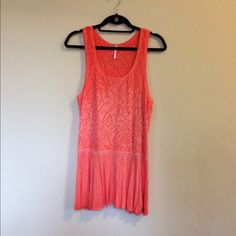 Free People Coral Tunic Tank Free People Coral Tunic tank. Laser cut out print. Flowy bottom. Size large Free People Tops