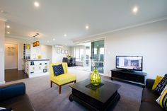 The open plan living is even more spacious when the sliders are open to the outdoors