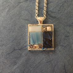 Mosaic pendant necklace made of blue Van Gogh mosaic tile, blue and white stained glass, beads, and silver celtic design beads