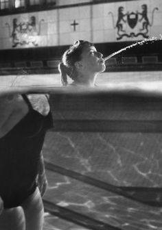 Swimmer Kathy Flicker spits water in a swimming pool in 1962.