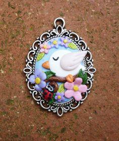 Cameo pendant decorated with flowers bird and ladybird in polymer clay handmade - Ciondolo cameo decorato con fiori uccellino e coccinella in fimo fatti a mano