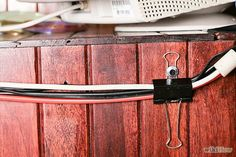 Keep cords off the floor and out of sight by attaching a couple binder clips to the back of your desk or entertainment center.