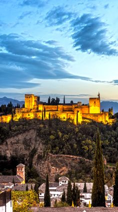 The Alhambra, a palace and fortress complex originally constructed as a small fortress until its ruins were rebuilt by the king Mohammed ben Al-Ahmar in Granada, Andalusia, Spain | 10 Most Beautiful Castles in Europe #travelblogger