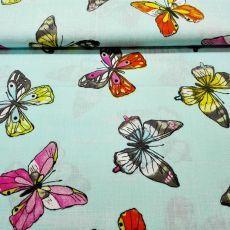 Tyrkysová látka s motýľmi